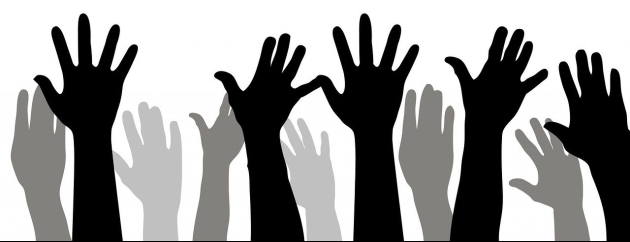 raised hands as if voting